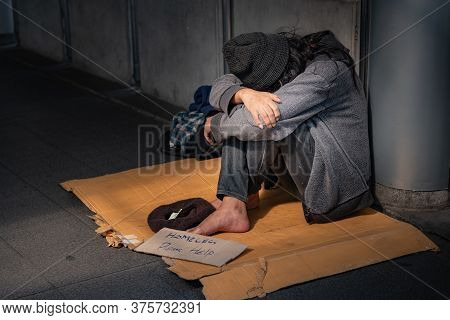 Beggars, Homeless People Sitting On The Floor, Ask For A Fraction Of Money From People Travelng To B