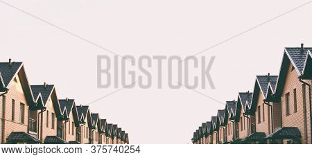 A lot of townhouses made of brick in the line