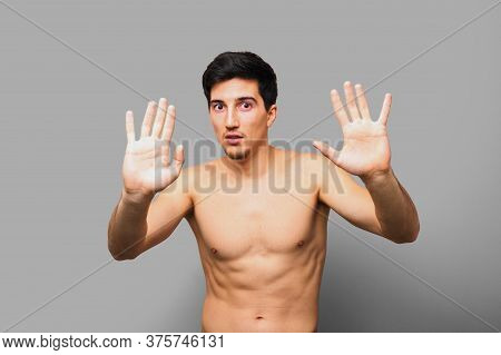 Naked Scared Brunette Man With Open Hands In Front Saying He Is Not Guilty Or Asking For Mercy Again