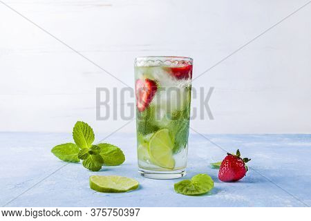 Mojito Cocktail With Ice Cubes. Glass Of Summer Lemonade Or Ice Tea. Refreshing Cool Detox Drink Wit
