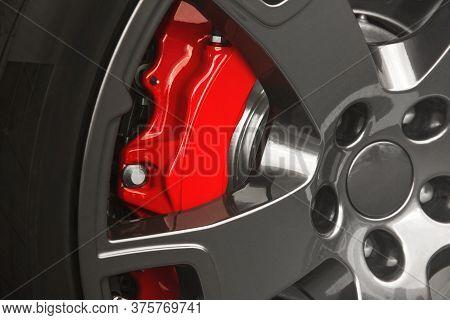 Car Wheel. Brake Discs. Red Car Caliper. Background. For Advertising.