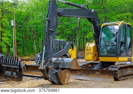 Group Of Excavator Working On A Construction Site Mini Excavator Equipped
