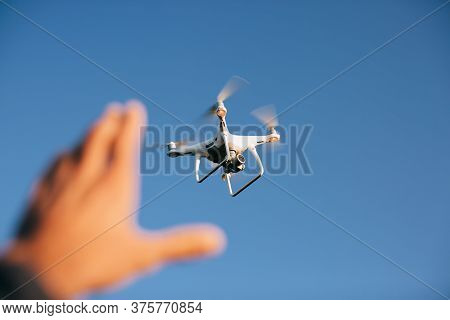 Drone Copter With The Camera Flies In The Blue Sky