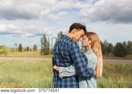 Blonde Girl And Dark Hair Guy Happily Together In Nature, Love Story