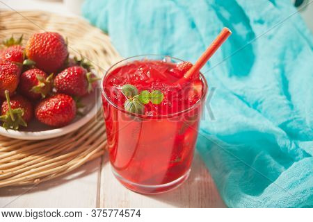 Glasses With Fresh Homemade Strawberry Sweet Iced Tea Or Cocktail, Lemonade With Mint Leaves. Refres