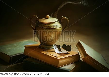Among The Old Battered Books There Is An Old Oriental Lamp With A Genie That Grants Wishes, From Whi