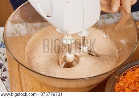 Mixer Blades Immersed In The Mass When Preparing The Dough. White Mixer During Work.