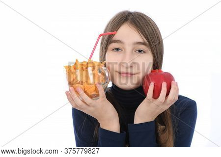 Pre-adolescent Girl Weigh Bowls Full Of Potato Chips And Red Apple. Isolated On White Background. Hi