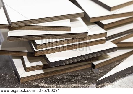 Stacked White Textolite Sheets. This Is Layered Composite Material Based On Fabric From Fibers And A