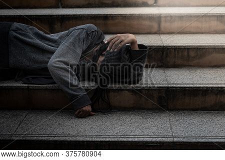 Beggars, Homeless People Lie On The Steps, Ask For A Fraction Of Money From People Travelng To Buy F