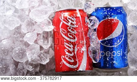 Two Cans Of World's Most Popular Soft Drinks: Coke And Pepsi
