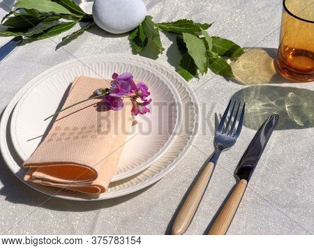 Festive White Table Setting With White Plates, Pink Napkins And Decorations Top View. Wedding Table