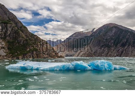 Huge Chunks Of Ice Floating In The Water In Tracy Arm Fjord In Alaska
