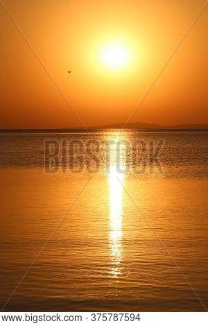 Sunset Above Sea. Beautiful Summer Decline Above Ocean. Beautiful Blazing Sunset Landscape Above Red