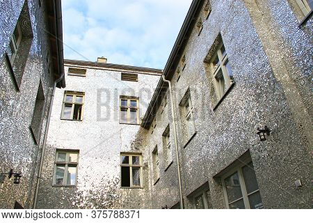 Building With Mirrored Walls. Facade Of Building Made Of Mirror Fragments. Walls Of House Are Covere