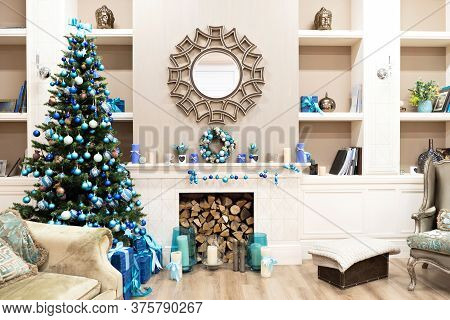 Beautiful New Year Interior With Christmas Tree In Corner. White Commode And Decorated Mirror On Wal