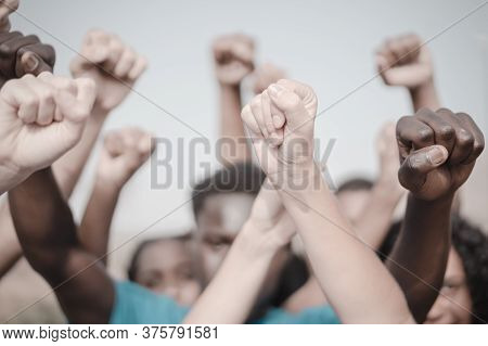 People Raised Fist Air Fighting For Their Rights. Labor Movement, Election Movement, No Racism And U