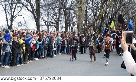 Odessa, Ukraine - 04 01 2019: Young Pirates On A City Street Walk Past A Crowd Of Spectators In Hono