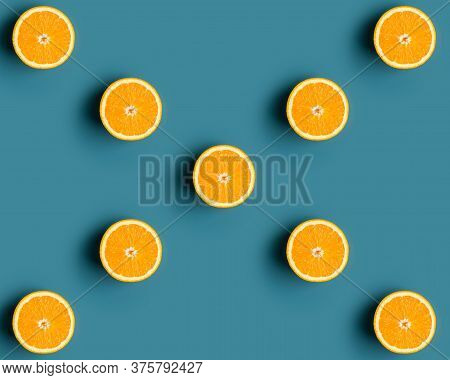 Copy Space With Pattern With Orange Fruit At Blue Background. Cross Shape With Half Oranges As Poste