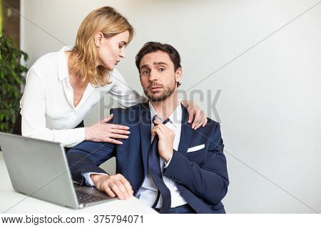 Blonde Boss Businesswoman Seduces Her Male Assistant Working With Laptop Computer.seducing A Subordi