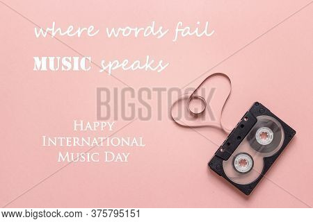 International Music Day Background With Audio Cassette Tape In The Shape Of Heart On Pink Background