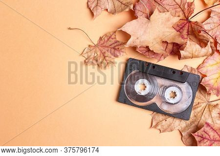 Audio Cassette Tape With Autumn Maple Leaves And Copy Space. Melancholy Music For Autumn Mood. Nosta