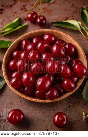 Harvest Time Concept With Ripe Sour Cherries In Wooden Bowl, Close Up
