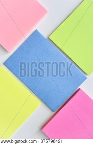 Selective Focus, Bright Colorful Square Blocks And Blue Rectangle In The Center