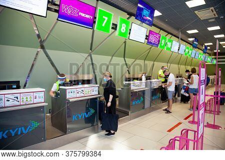 Kyiv, Ukraine - June 26, 2020: Masked People At The Kyiv Airport. Public Place During The Quarantine