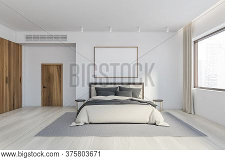 Interior Of Modern Master Bedroom With White Walls, Wooden Floor, Comfortable King Size Bed With Rou