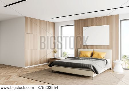 Corner Of Modern Master Bedroom With White And Wooden Walls, Wooden Floor, Comfortable King Size Bed