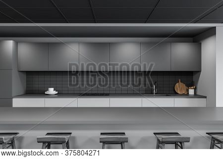 Comfortable Long Gray Bar Counter With Wooden Stools Standing In Stylish Pub With White And Gray Wal