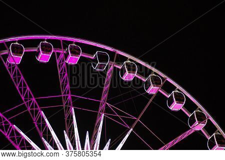 Beautiful View Of The Ferris Wheel At Night. Night Illumination Of The High Ferris Wheel.