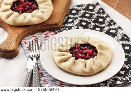 Healthy Breakfast. Homemade Lenten Galette With Elderberries And Cowberries