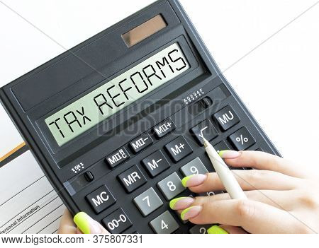 A Calculator With Text Tax Reforms On The Display