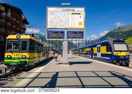 Grindelwald, Switzerland - July 30 2019 : Trains Of The Wengernalpbahn And Berner Oberland Bahn At T