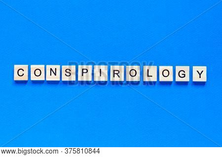Conspirology. Conspiracy Theory - Words Made Of Wooden Blocks With Letters, Conspiracy Theory Concep