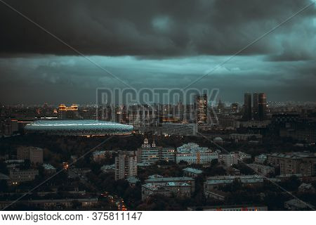 Dark Evening Stormy Cityscape: Aerial View From A Drone Of A Night Urban Cityscape With The Deep Tea
