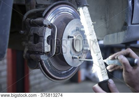 Repair Of Car Brake Discs. Replacement Of Car Brake Pads.