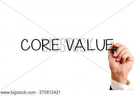 Core Value Concept. Male Hand Writes Core Values