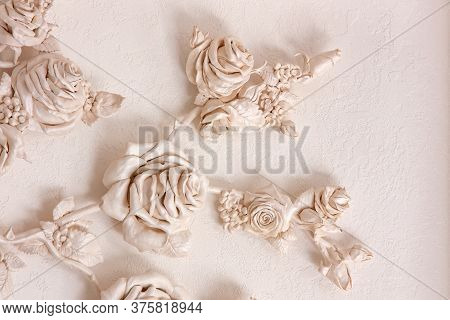Ceramic Roses On The Wall With Venetian Stucco. Tenderness And Beauty In A Stone Product.
