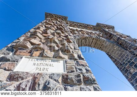 Low Angle View Of The Roosevelt Arch At The North Entrance Of Yellowstone National Park In Gardiner,