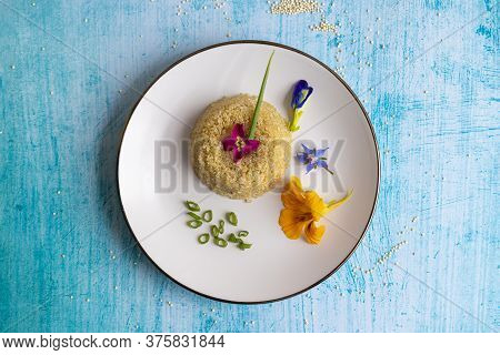 Quinoa Plate Presentation Decorated With Edible Flowers