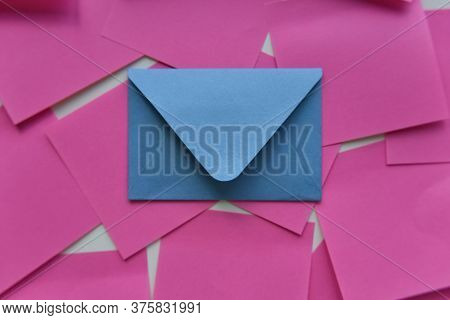 Selective Focus, Single Blue Envelope In The Middle Of Pink Stickers