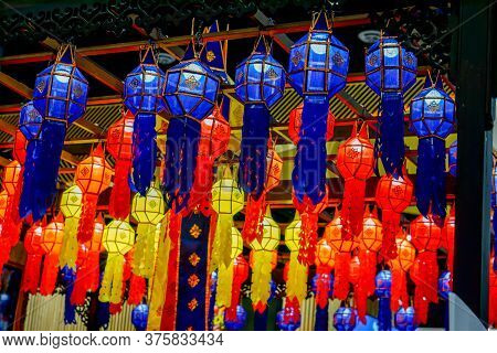 Closeup And Look Up View Of Decorated Thai Lanna Style Lanterns To Hang On Hotel Lobby Ceiling Backg