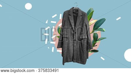 Gray Women Coat On Hanger With Plants Isolated On Abstract Colorful Background. Ladies' Trench Coat.