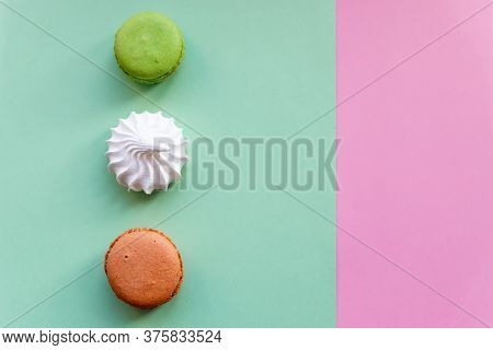 Flat Lay Of French Macarons And Meringues On Colorful Background. Top View.white Meringues, Many Swe