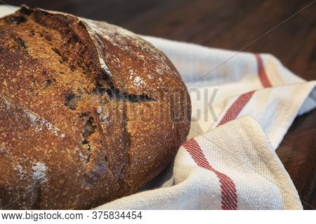 Baked Loaf Of Artisanal Whole Wheat Rustic Sourdough Bread With Black Olives, Photo Series