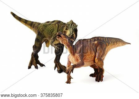 Green Tyrannosaurus Dinosaurs Are Hunting For Isolated Prey On A White Background.