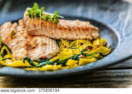 Chicken Cooked With Vegetables And Rice On A Plate. The Food In The Restaurant. Food Styling And Res